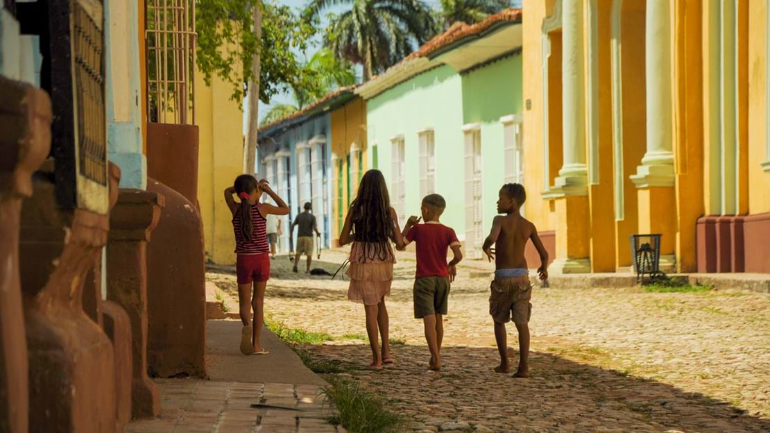 TRINIDAD, CUBA - MAY 26, 2013  kids walking on the street in UNESCO protected city of Trinidad, Cuba..jpg